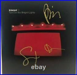 Autographed Interpol signed 12x12 Photo Album Cover Turn on the Bright Lights